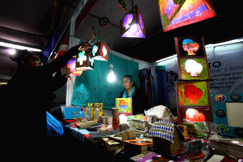 Visitors observe a stall at the Nepal-Bangladesh Trade Fair organized in Kathmandu, Nepal, Feb. 14, 2015. The fair is organized to promote products of Bangladesh .