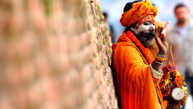A sadhu stands near Pashupatinath temple on the eve of Maha Shivaratri festival in Kathmandu, Nepal, Feb. 16, 2015. Hundreds of Sadhus from across Nepal and ...