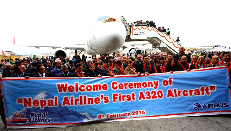Officials from Nepal Airlines, crew members and officials from the Embassy of France pose for a group photo after the arrival of Nepal Airlines new Airbus A320 ...