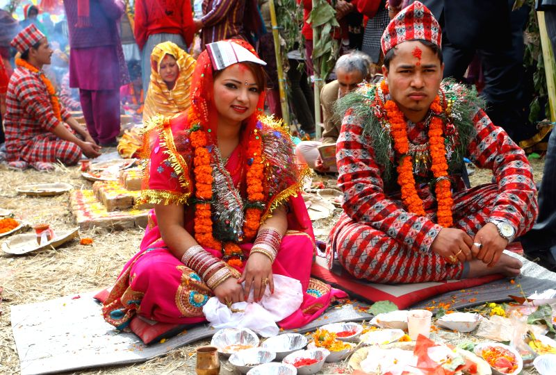 People attend a mass marriage for more than 100 couples in Kathmandu, Nepal, Feb. 8, 2015.