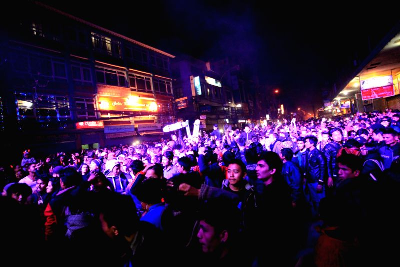 -- Nepalese youth enjoy the New Year count down party to welcome the year 2015 at a street of Thamel in Kathmandu, Nepal, Dec. 31,2014.