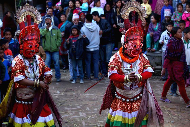 Masked men perform the Navadurga Dance at Sankhu, northwestern Kathmandu Valley of Nepal, Jan. 9, 2015. Navadurga means nine forms of Durga. (Xinhua/Pratap ...