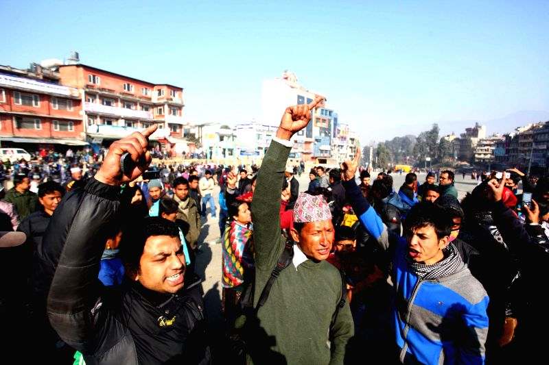 People of opposition political parties participate in a strike in Kathmandu, Nepal, Jan. 13, 2015. Normal life in many places across the country has been affected