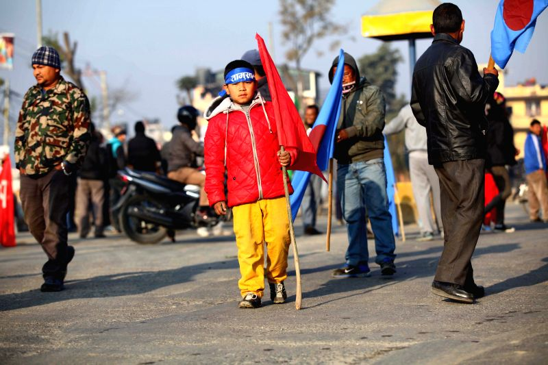 Young cadres of 30 agitating political parties carry the flag and participate in a strike led by Prachanda, Chairman of the Unified Communist Party of Nepal ...