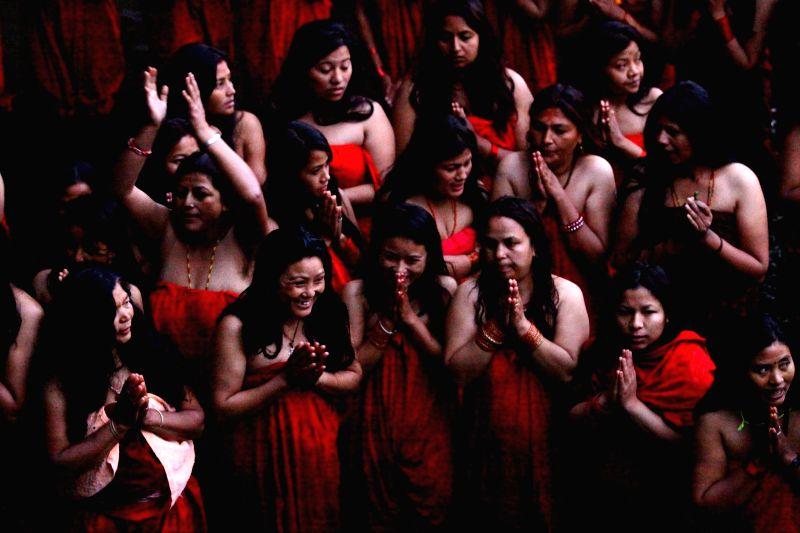 Nepalese Hindu women devotees take holy bath in the Shali River on the first day of Madhav Narayan festival at Sankhu in Kathmandu, Nepal, Jan. 5, 2015. Nepalese ..