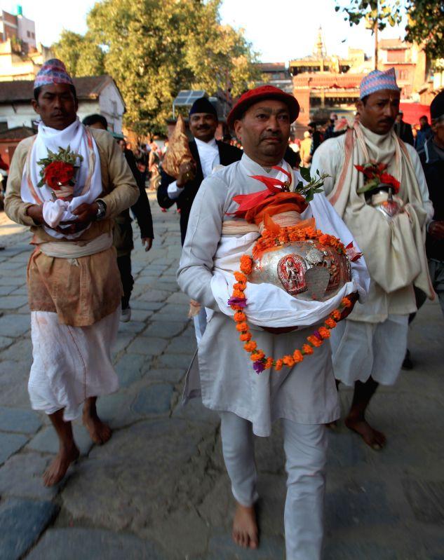 Priests with vessels carrying Changu Narayan proceed to Taleju temple during Changu Narayan festival in Kathmandu, Nepal, Jan. 5, 2015. The idol of Changu Narayan .