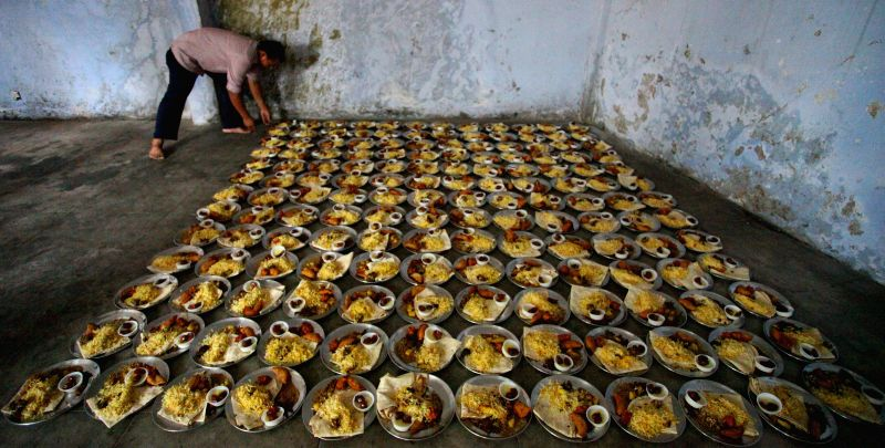 A man arranges the meals for distribution before breaking the fast during the Islamic holy month of Ramadan at the Kashmere Mosque in Kathmandu, Nepal, July 10, ..
