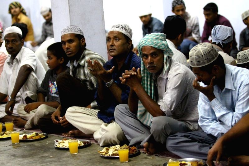 Muslims offer prayers before breaking the fast during the Islamic holy month of Ramadan at the Kashmere Mosque in Kathmandu, Nepal, July 10, 2014. (Xinhua/Sunil ..