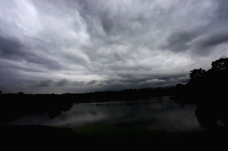 Photo taken on July 14, 2014 shows black clouds over the sky before heavy monsoon rains at Taudaha lake on the outskirts of Kathmandu, Nepal. The monsoon season ..