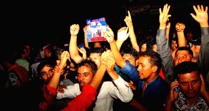 Cadres of the Communist Party of Nepal (United Marxist-Leninist) chant slogans after KP Oli was elected as the party's new chairman at the 9th general convention .