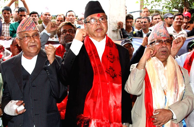 KP Sharma Oli (L), the newly elected chairman of CPN-UML, Communist Party of Nepal (United Marxist-Leninist) takes oath of secrecy with former chairman Jhalnath .. - Madhav Kumar Nepal