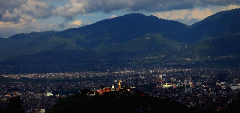 Photo taken on July 19, 2014 shows a valley view along with Swayambhu and Dharahara from the Ichangu Hill in Kathmandu, Nepal.