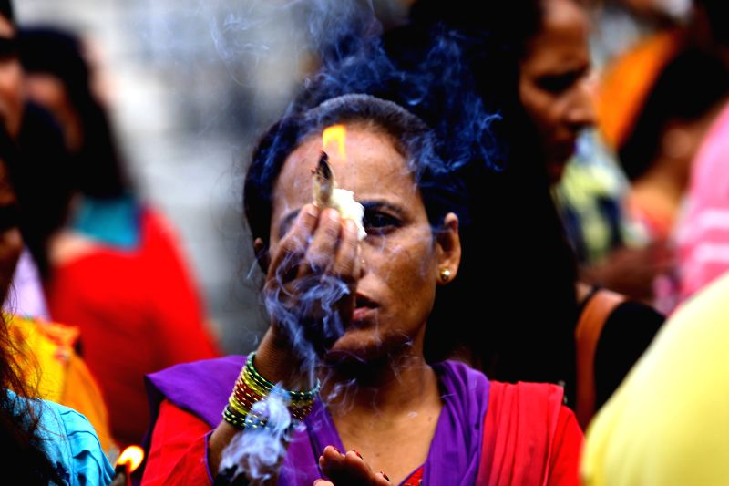 A Hindu woman offers prayers on Shrawan Somvar at Pashupatinath temple in Kathmandu, Nepal, July 21, 2014. Shrawan Somvar (Monday) is considered auspicious for ...