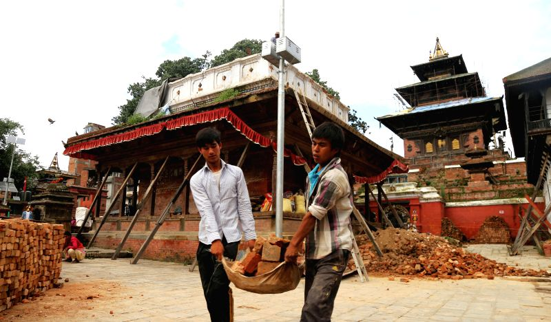 KATHMANDU, July 21, 2016 - Workers carry bricks at a reconstruction site of a damaged temple at Hanumandhoka Durbar Square, a UNESCO heritage site in Kathmandu, Nepal, July 20, 2016. Heritage ...