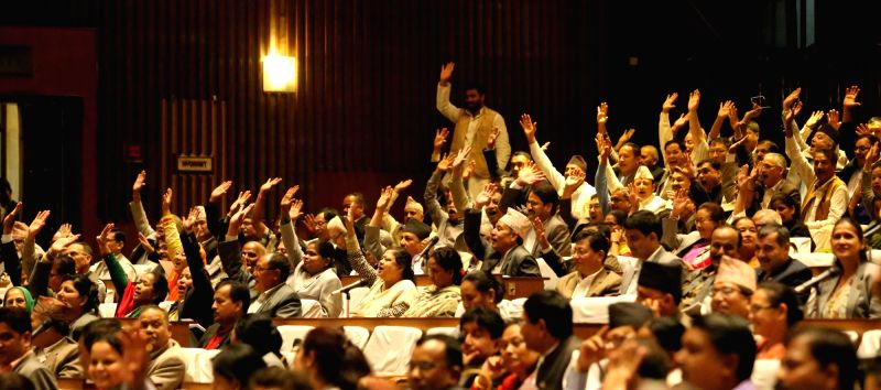 KATHMANDU, July 23, 2016 - Majority of parliamentarians of opposition parties raise hands rejecting the budget-related bills during the discussion of the no-confidence motion filed against Prime ...