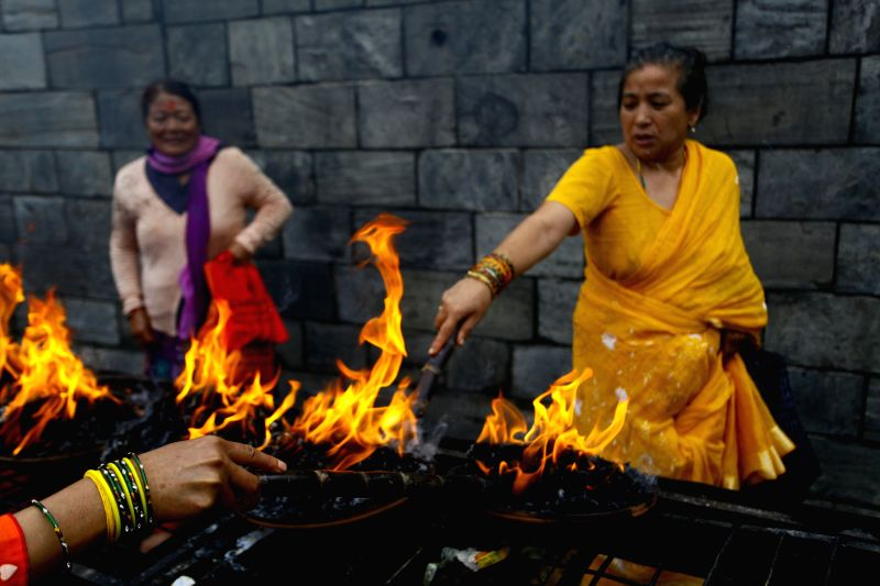 KATHMANDU, July 25, 2016 - Hindu devotees offer prayers on second week of Shrawan Somvar at Pashupatinath Temple in Kathmandu, Nepal, July 25, 2016. Shrawan Somvar (Monday) is considered auspicious ...
