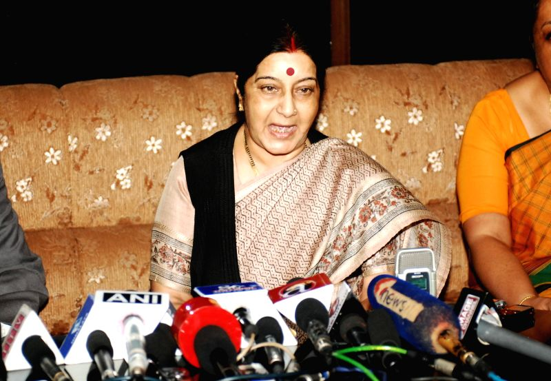 Indian Minister of External Affairs Sushma Swaraj (C) attends a press conference upon her arrival at Tribhuvan International Airport in Kathmandu, Nepal, July 25, - Sushma Swaraj