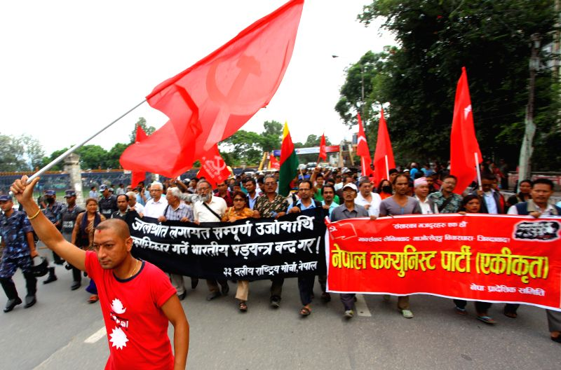 Participants of opposition alliance march during a protest against the upcoming the 3rd Nepal-India Joint Commission meeting in Kathmandu, Nepal, July 25, 2014. .. - Sunil Sharma