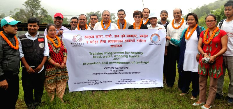 KATHMANDU, July 26, 2016 - Participants pose for a group photo during the opening of Wash project along with the training programme for healthy food, water, washing hands and promotion and management ...