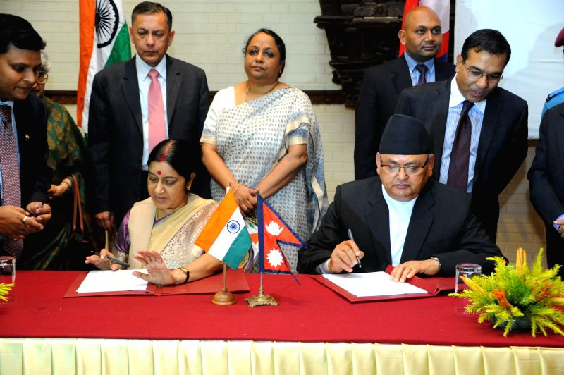 India's Minister for External Affairs Sushma Swaraj (L) and Nepalese Minister of Foreign Affairs Mahendra Bahadur Pandey sign agreements after the conclusion of .. - Sushma Swaraj