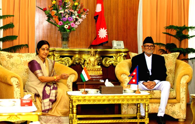 India's Minister for External Affairs Sushma Swaraj (L) meets with Nepalese Prime Minister Sushil Koirala during her visit for the 3rd Nepal-India Joint ... - Sushil Koirala and Sushma Swaraj
