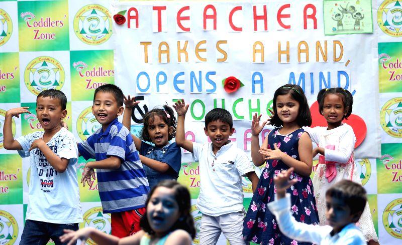KATHMANDU, July 27, 2018 - Children perform during celebrations of the Teachers' Day at a local school in Kathmandu, Nepal, July 27, 2018.