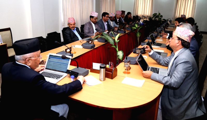 KATHMANDU, July 27, 2018 - Nepali Prime Minister K.P. Sharma Oli and members of the Council of Ministers use laptop computers in cabinet meeting in Kathmandu, Nepal, July 26, 2018. This was the first ... - K. and P. Sharma Oli