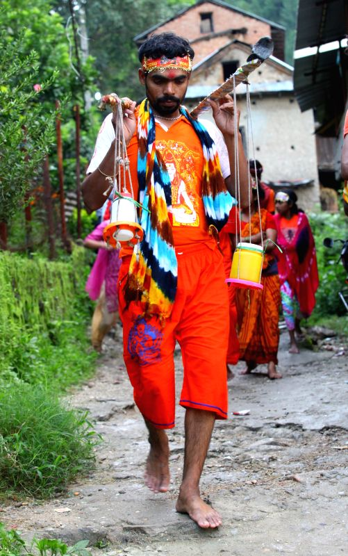 Hindu devotees walk towards the Pashupatinath Temple from Sundarijal in Kathmandu, Nepal, on July 28, 2014. Devotees run about 15km to the temple on their bare ...