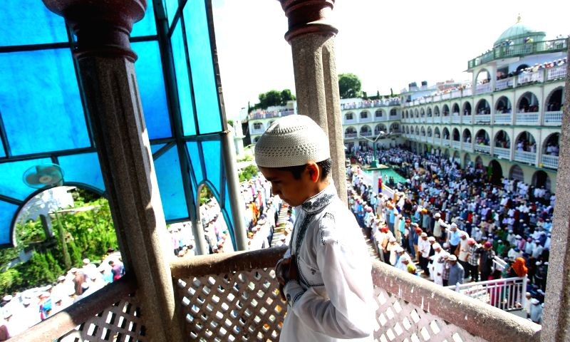 A boy attends a mass prayer at Kashmiri Takiya Jame mosque on Eid al-Fitr in Kathmandu, Nepal, July 29, 2014. Eid al-Fitr marks the end of the holy month of ...