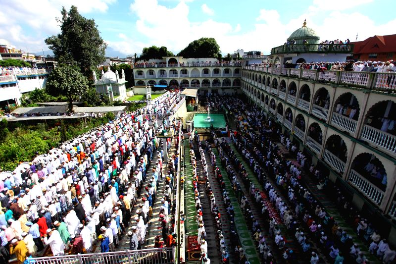 Muslims attend a mass prayer at Kashmiri Takiya Jame mosque on Eid al-Fitr in Kathmandu, Nepal, July 29, 2014. Eid al-Fitr marks the end of the holy month of ...