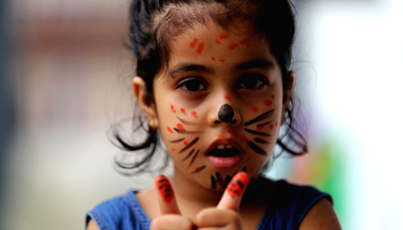 KATHMANDU, July 29, 2016 - A Nepalese kid gestures with tiger patterns on fingers in the celebration of International Tiger day in Kathmandu, Nepal, July 29, 2016. International Tiger day is ...