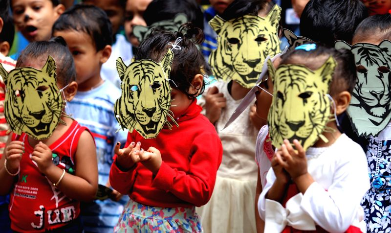 KATHMANDU, July 29, 2016 - Nepalese kids gesture wearing tiger masks in the celebration of International Tiger day in Kathmandu, Nepal, July 29, 2016. International Tiger day is celebrated annually ...