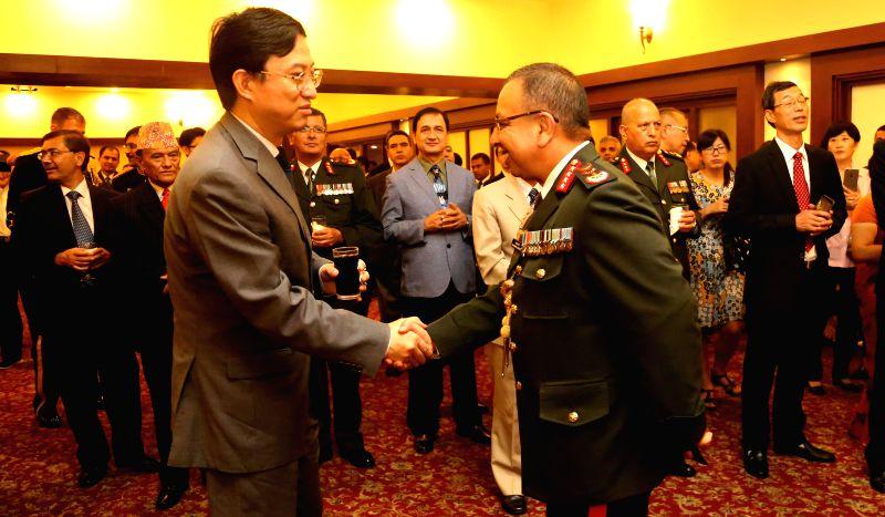 KATHMANDU, July 30, 2016 - Chinese Ambassador to Nepal Wu Chuntai (L) shakes hands with Nepalese Chief of Army Staff (CoAS) Rajendra Chhetri during a reception celebrating the 89th Anniversary of ...