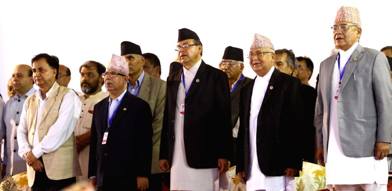 Jhala Nath Khanal (3rd R, front), chairman of the Communist Party of Nepal (United Marxist-Leninist), attends the inauguration of the 9th general convention of the - Jhala Nath Khanal