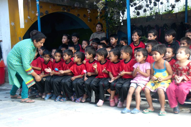 Nepalese social worker Pushpa Basnet (front), who was awarded the CNN Heroes Award 2012 for her work with the children of jailed women, visits inmates' children in