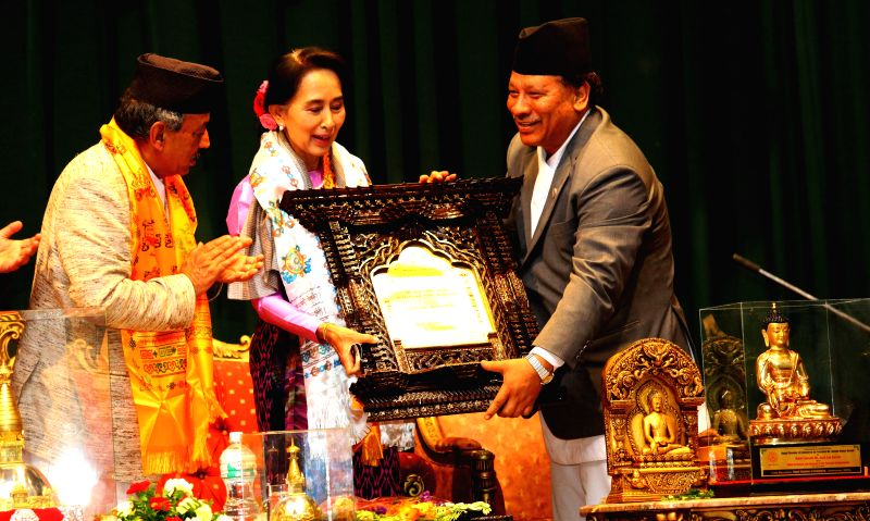 Aung San Suu Kyi(center), leader of Myanmar's opposition party National League for Democracy, is is honoured with Dr Dilli Raman Regmi International Peace Award ..