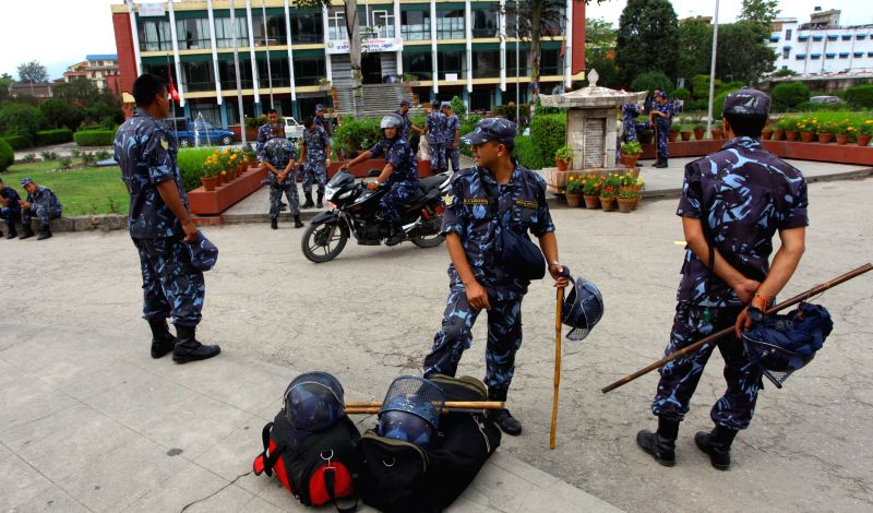Security personnel are seen before the Constituent Assembly (CA) by-election in Kathmandu, Nepal, June 20, 2014. Nepal police has planned to beef up security in ..