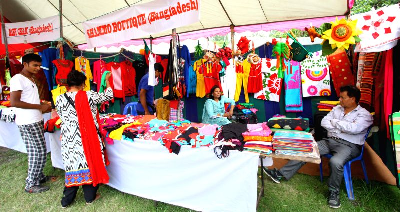 Visitors buy products at a stall during the Nepal-Bangladesh Trade Fair at City Hall in Kathmandu, Nepal, June 27, 2014. The fair was organized to promote ...