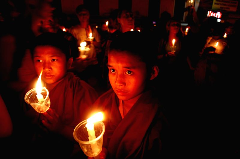 Buddhist monks take part in a candle light vigil at Boudhanath stupa a month after the April 25 earthquake in Kathmandu, Nepal, June 2, 2015. The massive ...