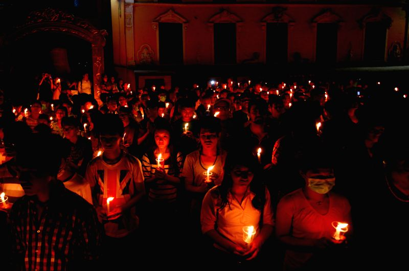 People take part in a candle light vigil at Boudhanath stupa a month after the April 25 earthquake in Kathmandu, Nepal, June 2, 2015. The massive earthquake which ...