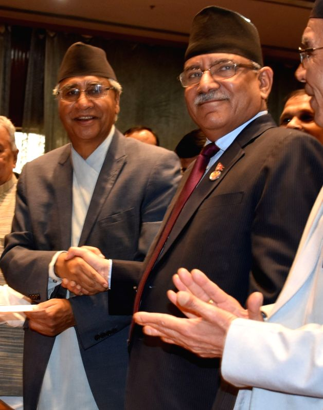KATHMANDU, June 3, 2017 - President of the Nepali Congress party Sher Bahadur Deuba (L) shakes hands with caretaker Prime Minister Pushpa Kamal Dahal (R) after filing his nomination for the election ... - Pushpa Kamal Dahal