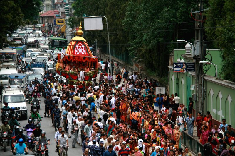 Nepalese devotees participate in the pulling of the chariot of Lord Jagannath during annual Rath Yatra, or Festival of Chariot in Kathmandu, Nepal, June 29, 2014.