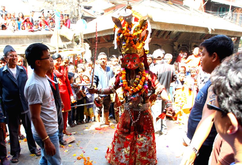 "A masked dancer performs as part of ""Devi Pyankha"" (Devi Dance in local language) to mark the Ghode Jatra (horse racing festival) in Kathmandu, capital ..."