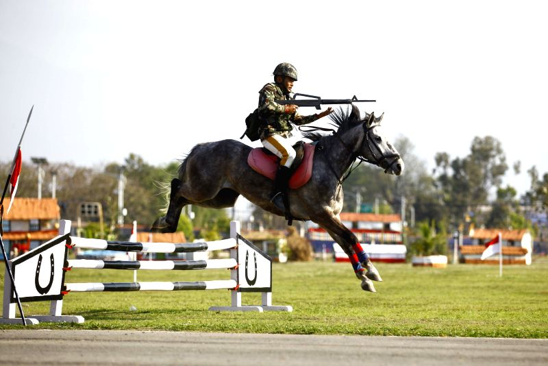 A Nepal army cavalry displays horse riding skills during the annual Ghode Jatra (Horse Racing Festival) held at the Army Pavilion in Tundikhel, Kathmandu, Nepal, ...