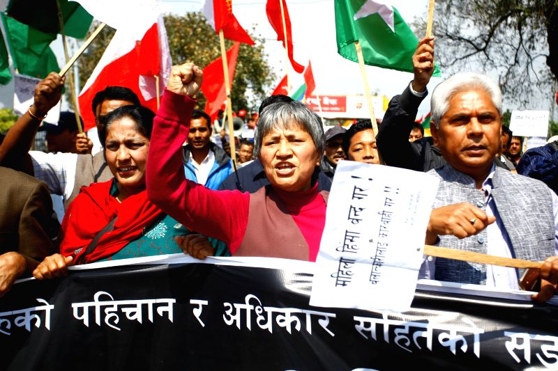 Political leaders of the United Communist Party of Nepal (Maoist) shout slogans during a protest against women violence in Kathmandu, Nepal, March 22, 2015. ...