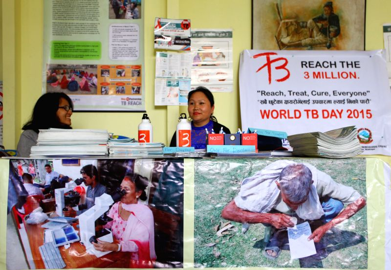 Health workers sit in a stall during a program marking the World Tuberculosis day in Kathmandu, Nepal, March 24, 2015. The World Tuberculosis Day is celebrated ... - Sunil Sharma