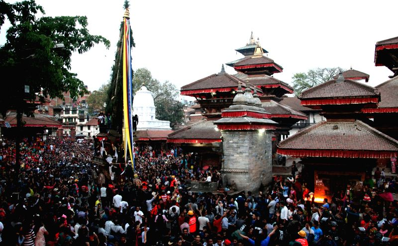 The chariot of Seto Machhendranath is pulled by devotees during the second day of Seto Machhindranath Chariot festival at Hanumandhoka in Kathmandu, Nepal, March ...