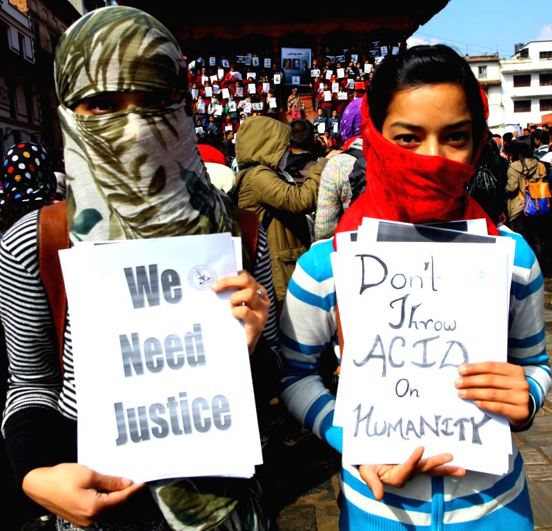 "Nepalese girls holding placards attend a protest program ""scarf movement"" organized to against an acid attack on two school children, Sangita Magar and ..."