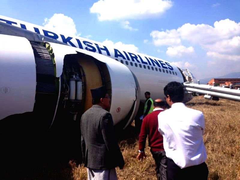 Nepal's Minister for Culture, Tourism and Civil Aviation Deepak Chandra Amatya (1st L) visits the incident site of a Turkish Airlines Airbus plane at Tribhuwan ...