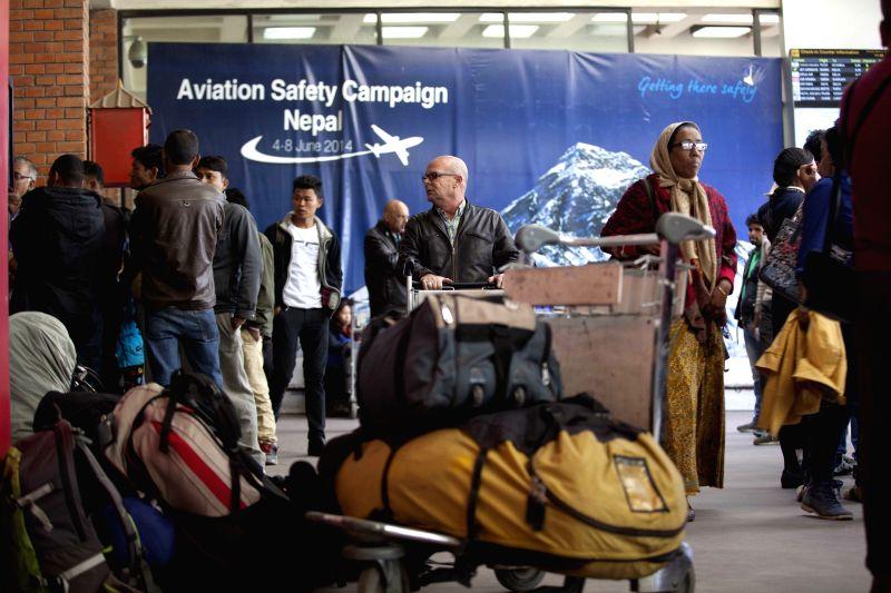 Passengers wait to return to their hometown at Tribhuwan International Airport in Kathmandu, Nepal on March 7, 2015. Nepal's only international airport, the ...